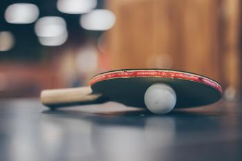Selective Focus Photo of Table Tennis Ball and Ping-pong Racket