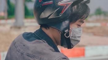 Selective Focus Photography of Person Wearing Black and Red Helmet and Gray Mask