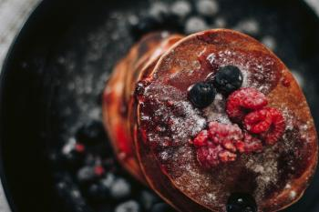 Selective Focus Photography of Raspberry and Blueberry Pancakes