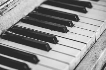 Selective Focus Photography of Upright Piano