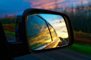 Selective Focus Photography of Vehicle Side Mirror