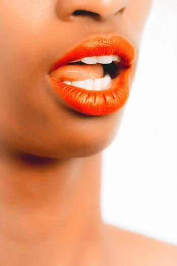 Selective Focus Photography of Woman With Orange Lipstick