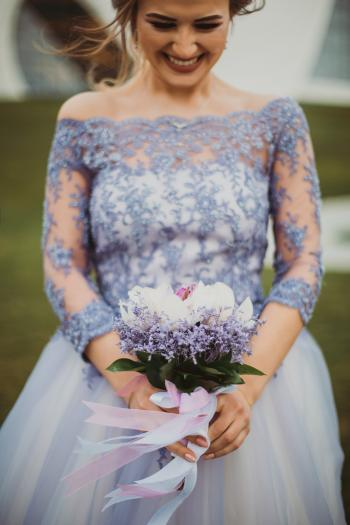 Shallow Focus on Purple Floral Off-shoulder Long-sleeved Lace Wedding Gown