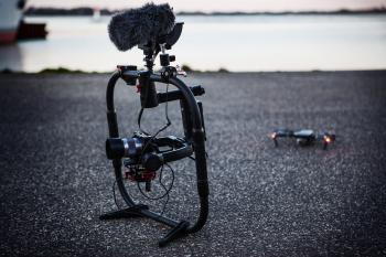 Shallow Focus Photography of Black Quadcopter Near Body of Water