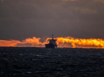 Ship on sunset fire