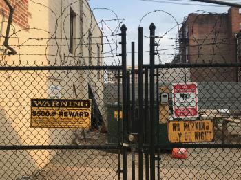 Signs and fence along W. 23rd Street between Maryland Avenue and Morton Street, Baltimore, MD