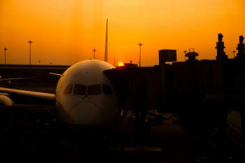 Silhouette of Airplane on Airport during Sunset