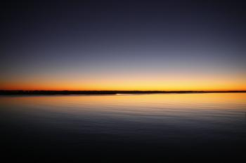 Silhouette of Calm Sea Under Blue and Orange Clear Sky during Sunset