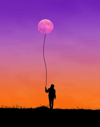 Silhouette of Man Holding String Connected to Moon