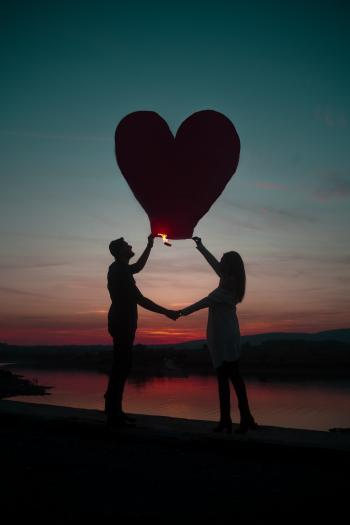 Silhouette Photo Of Man And Woman Holding Heart Lantern