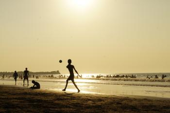 Silluhette of Man Playing Ball Near the Seashore