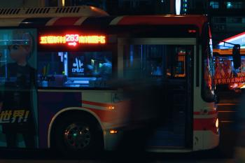 Silver City Bus on a City Street at Night