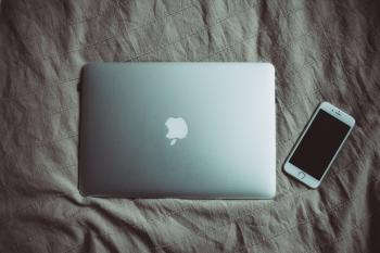Silver Macbook Beside Silver Iphone 6