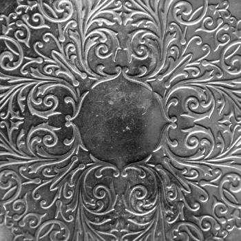 Silver metal plate with classic ornament