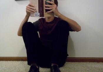 Sitting on floor reading