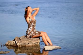 Sitting Woman Wearing Leopard Tank Mini Dress on Body of Water