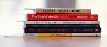 Six Assorted-title Books on White Desk
