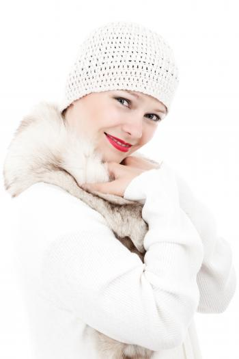 Smiling Woman Wearing White Knit Cap and White and Beige Fur Lined Coat