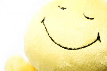 Smiling yellow toy