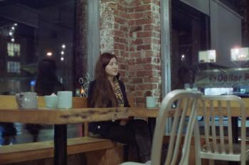 Smirking at a Cafe