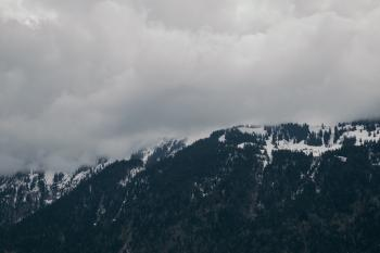 Snow-capped Mountain Under Cloudy Sky