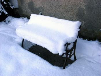 Snow-covered garden seat