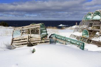 Snow covered lobster traps near ocean