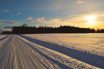 Snow Covered Road during Golden Hour