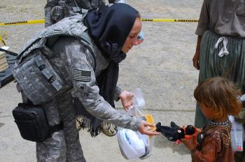 Soldier giving Toys to Kids