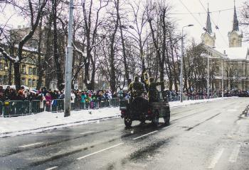 Soldiers Riding a Vehicle during a Parade