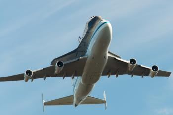 Space Shuttle Endeavour and carrier plane passing directly overhead in Marin Headlands