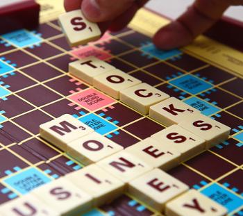 Spelling Out Business Stocks And Money Using Tiles
