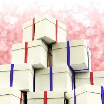 Stack Of Giftboxes With Bokeh Background As Presents For The Family