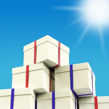 Stack Of Giftboxes With Sun And Sky Background As Presents For The Fam