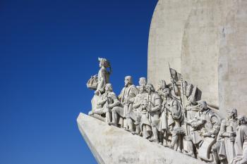Statue on Roof Under White and Blue Sky