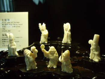 Statues behind glass