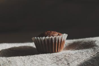 Still Life Photography of Muffin on White Textile