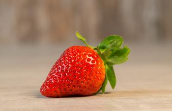 Strawberry Fruit on Brown Wooden Surface