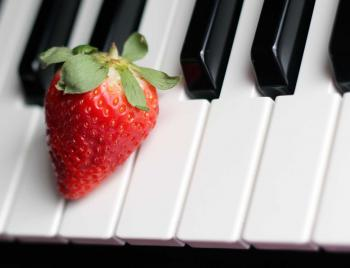 Strawberry on Top of Piano Keys