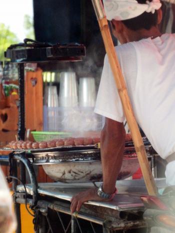 Street Vendor Cooking Sausages