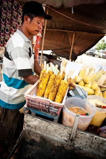 street vendor selling corn on the street