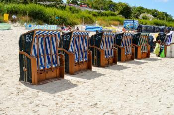 Sun beds - basket on a sandy beach