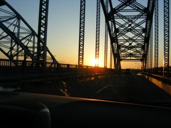 Sun set through a bridge