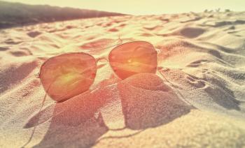 Sunglasses on the Sand at Sunset
