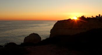 Sunset over the cliffs in Algarve