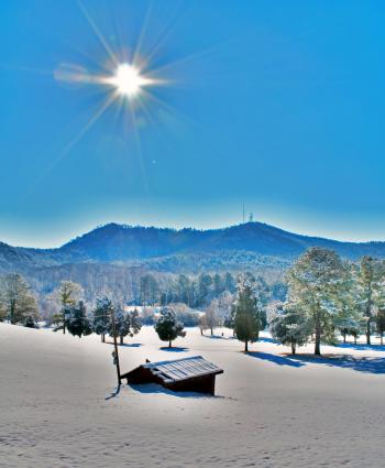 Sunshine over snowy landscape