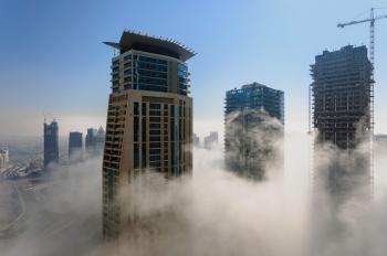 Three Brown High Rise Buildings