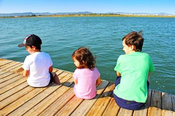 Three kids on the pier