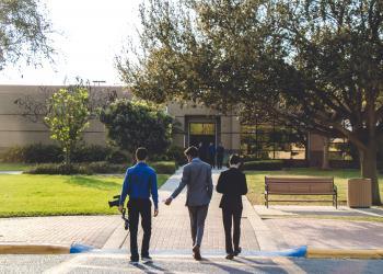 Three Man Walking on Street Wearing Suit Jackets