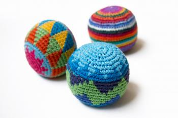 Three multi-colored juggling balls